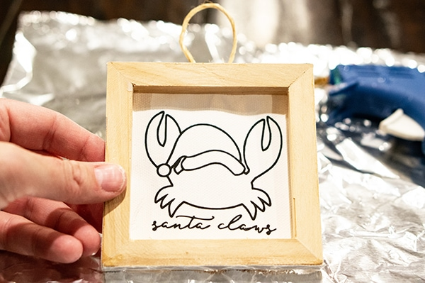 Reverse Canvas Ornament - learn how to make a fun and versatile DIY Christmas ornament using your Silhouette or Cricut. Free Christmas SVG and Silhouette files included. #christmasdecor #christmasornament #christmasdiy