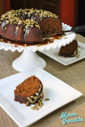 oatmeal-molasses pumpkin cake with caramel glaze and candied pumpkin seeds