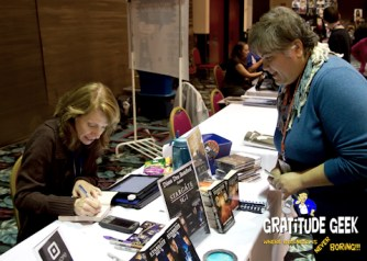 Diane Botsford at Space City Con autographing my copies of her Stargate SG:1 Fanfaction novels.