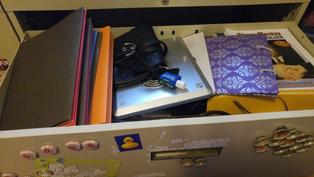 File Drawer Filled with Random Stuff