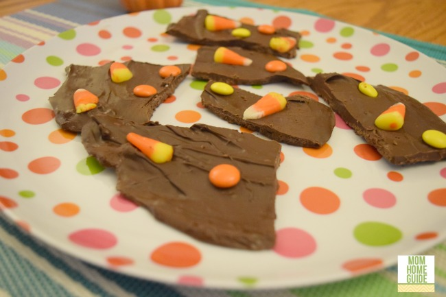 This homemade dark chocolate Halloween candy corn bark with candy corn and Reese's Pieces is simple to make!