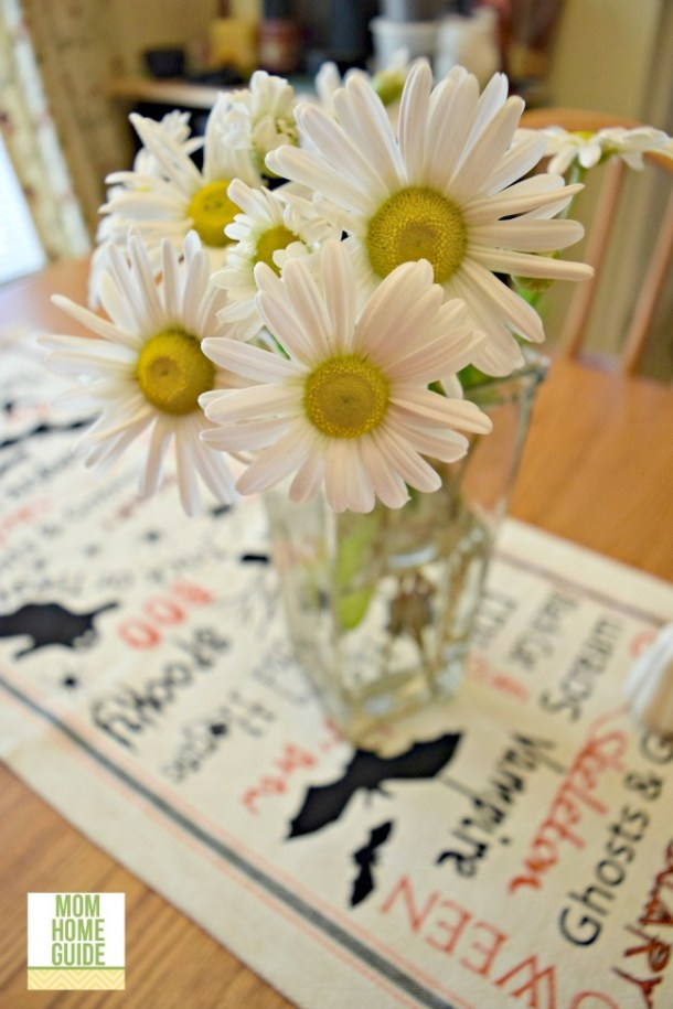Sweet daisy like mums in a vase on a farmhouse-style kitchen table
