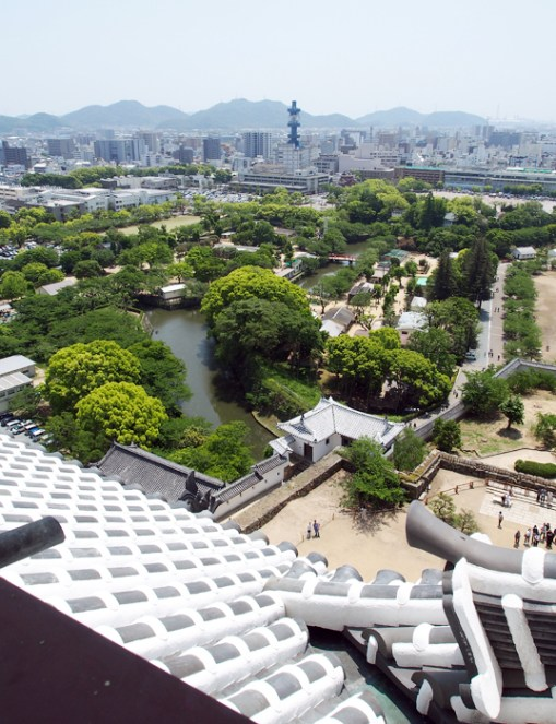 View of the Himeji Castle grounds, and the modern city of Himeji behind the trees