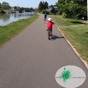 boys riding bikes on a paved path