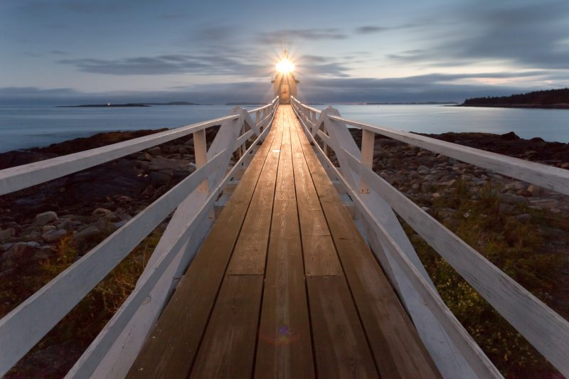 Picture of a long path with a light at the end