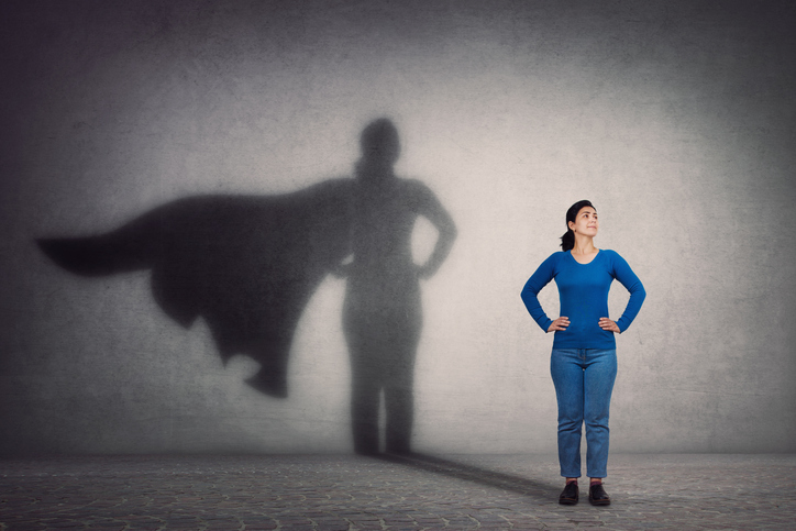 Mom who is pretending to be brave and strong like a superhero.