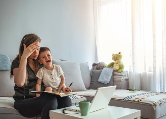 Mom multitasking instead of asking for help