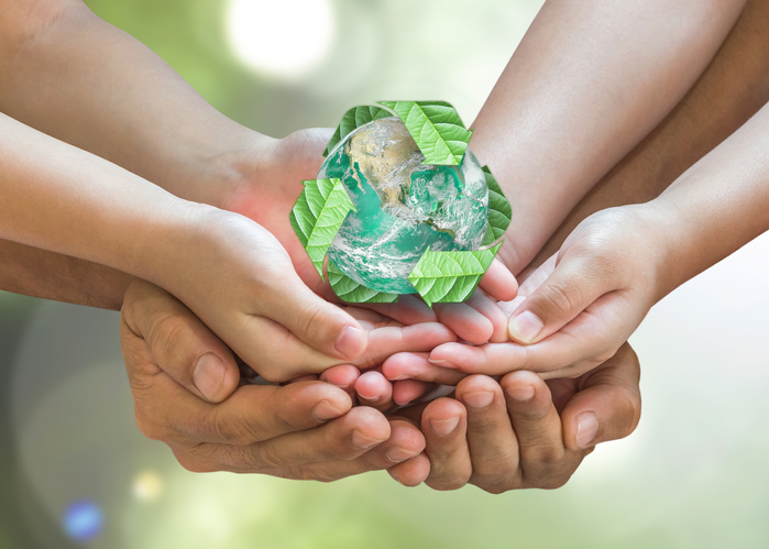 Mother and child holding hands with recycling icon on top showing how they are saving the environment