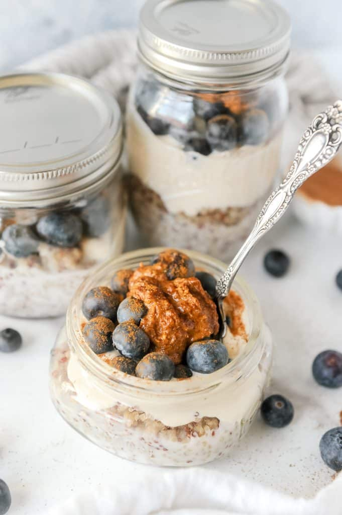 quinoa parfait topped with blueberries and almond butter