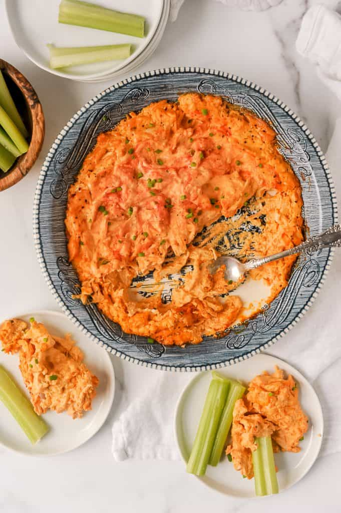 Keto buffalo chicken dip is a simple keto tailgate food you can make in the oven or crockpot. With just 4 ingredients like Neufchatel cheese, sour cream, buffalo sauce and chicken, this keto friendly appetizer is perfect for a crowd! Also delicious cold or add some blue cheese. Check out the video to see how to make this low carb buffalo chicken recipe.