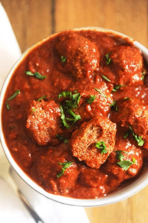 This recipe for crockpot meatballs is made with simple ingredients.  Almond flour, garlic, salt, and Parmesan cheese make these slow cooker meatballs delicious and gluten free.