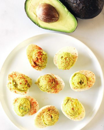 Keto deviled eggs with avocado are a delicious snack!  These low carb deviled eggs are an easy-to-make clean keto recipe with simple, whole food ingredients.