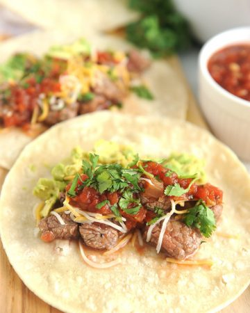 Instant Pot Carne Asada is easy and quick to make for delicious street tacos or instant pot steak nachos. Just a few simple ingredients make this carne asada recipe Whole30 and Keto compliant.
