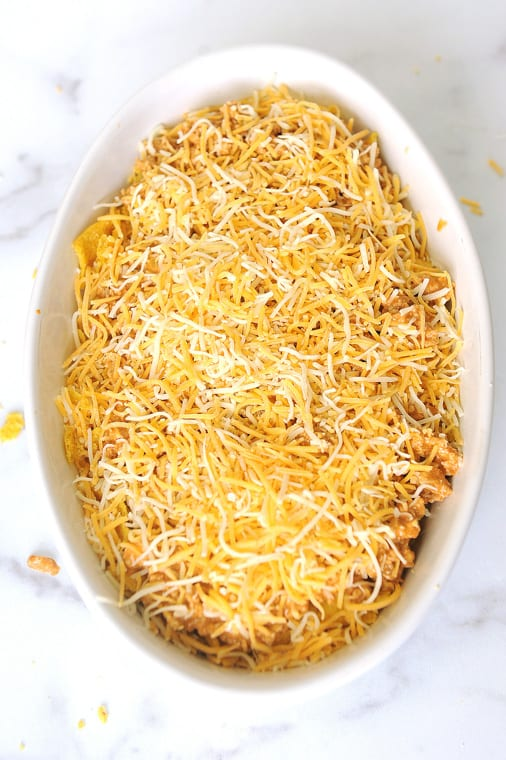 walking taco casserole bake with corn chips. Healthy recipe that takes the original in a bag recipe and lightens it up for a healthy casserole kids will love for dinner