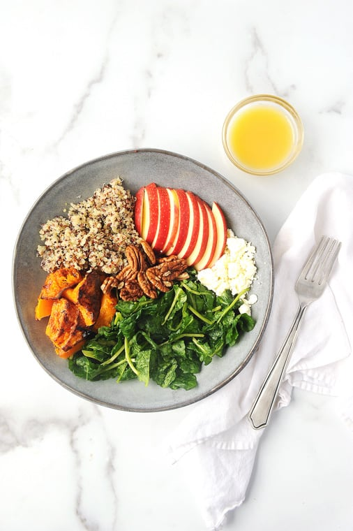 butternut squash salad using air fryer butternut squash, kale, apples and pecans. Delicious and healthy fall quinoa salad for thanksgiving or fall.