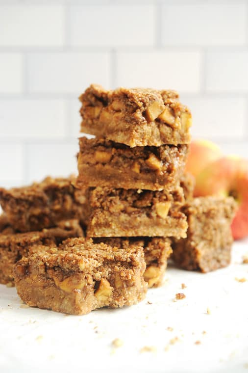 Paleo apple pie bars that are gluten free, dairy free and healthy! Topped with crumble and made with vegan salted caramel, these dutch apple pie bars will be a family favorite!
