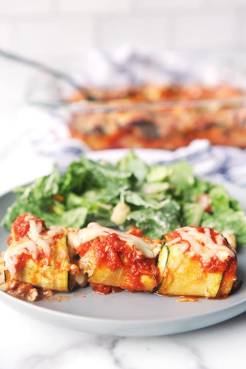 Zucchini Lasagna Rolls are an easy summer dinner to make using fresh zucchini! Zucchini, cheese & sausage is a low carb and healthy lasagna alternative!