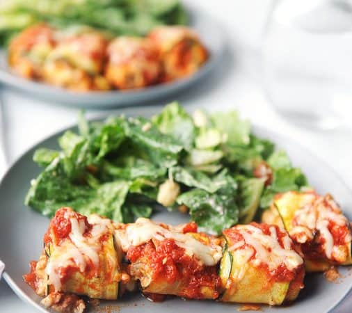 This easy keto zucchini lasagna rolls recipe is a family friendly dinner! Zucchini slices rolled around sausage, cheese, garlic and basil is a healthy summer dinner your family will love! #zucchini #lasagna #lowcarb #dinner