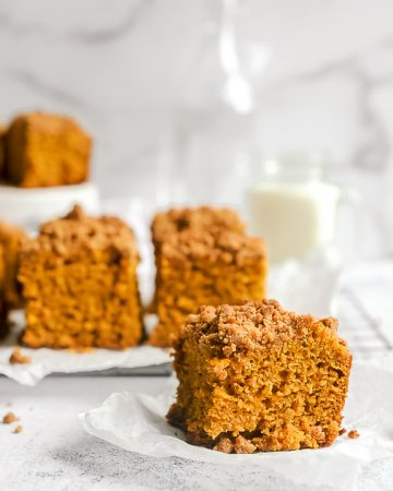 Dairy free pumpkin coffee cake with pumpkin spice streusel. Healthy and easy pumpkin spiced coffee cake for chilly fall mornings! Can be made with cake mix and in a 9X13 or 8X8 pan.