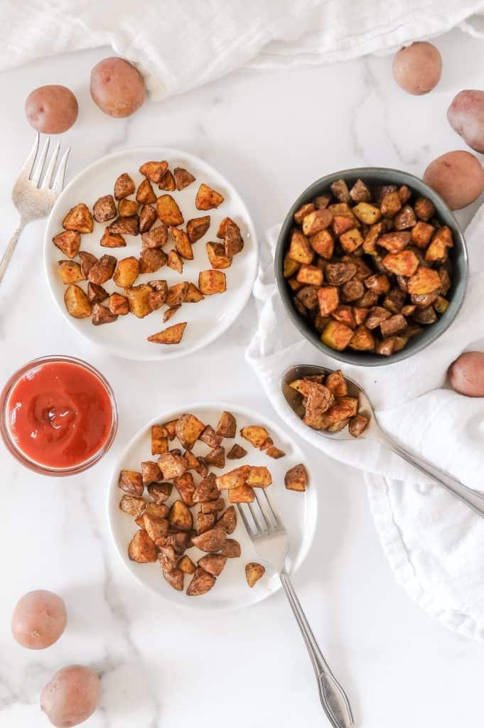 crispy potatoes for breakfast on plates