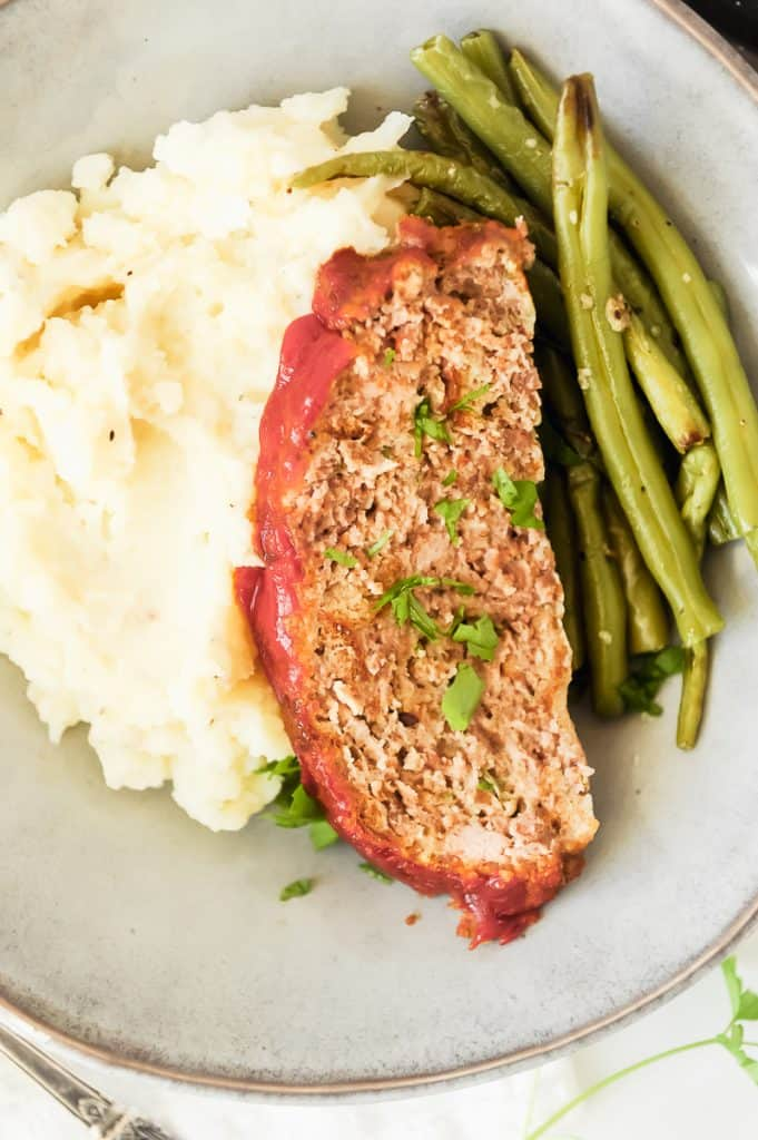 Meatloaf dinner with mashed potatoes and green beans