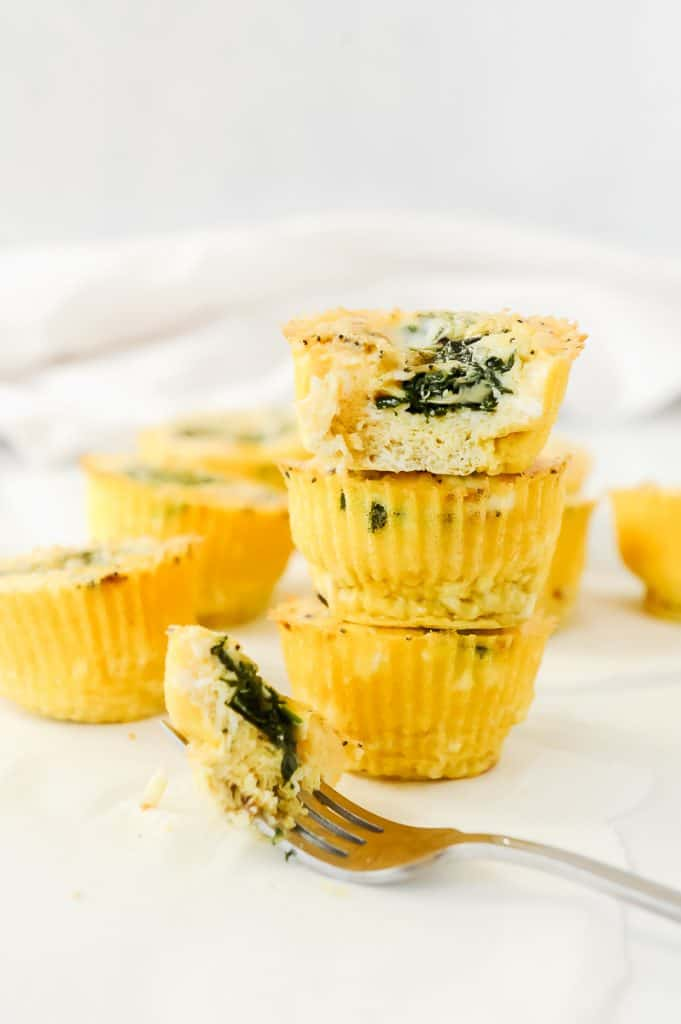 Spinach Feta Egg Muffins are delicious breakfast egg muffin cups that are easy to prep for a week of healthy breakfasts!  Simple ingredients like eggs, spinach and cheese make these egg muffins keto, ww and clean eating approved!