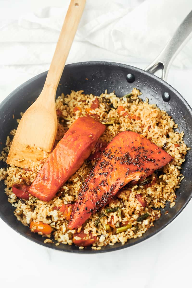salmon in a skillet with rice