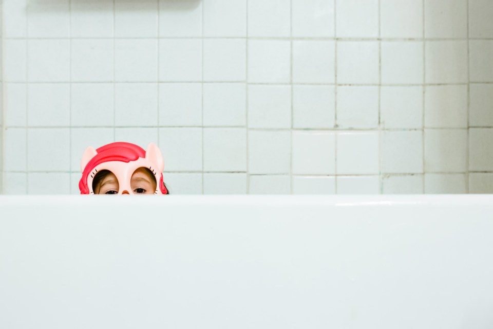 Little girl in tub