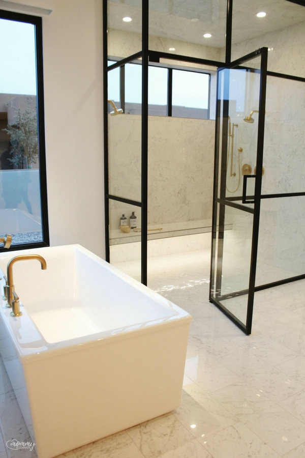 Modern bathroom. Heated tile. Gold Fixtures.