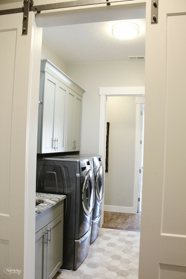 2 entrances to the laundry room with sliding barn doors, plus there was enough counter space to fold clothes! St. George Parade of Homes 2017Tour.