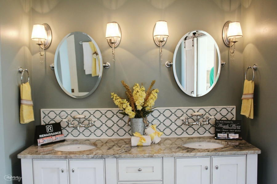 Cute cottage bathroom. Bathroom tile. oval mirrors.