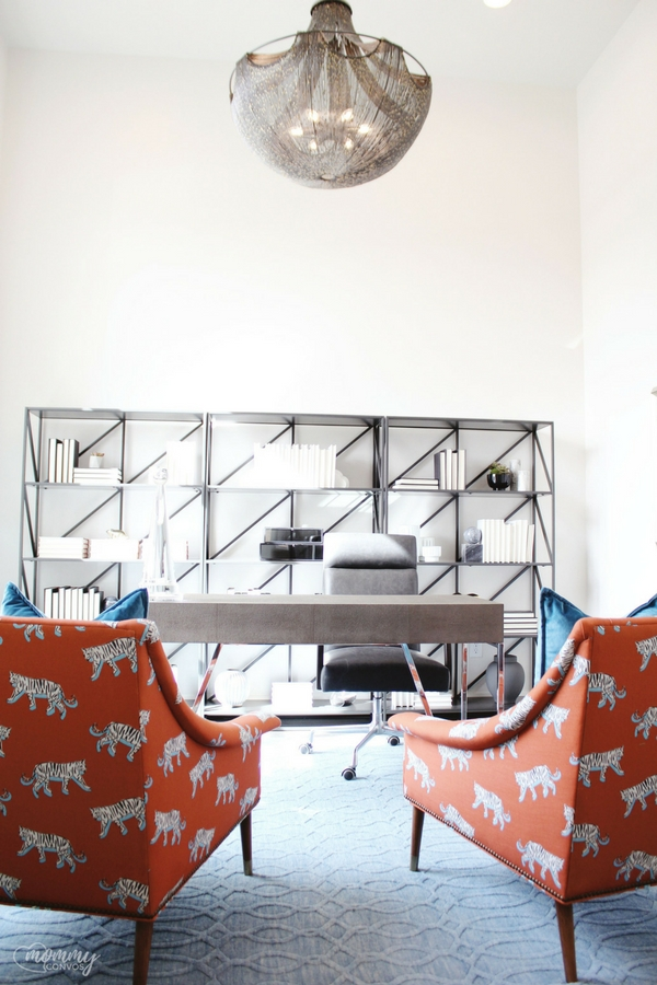 bright chairs in office. industrial shelving in office. books placed backwards on shelves. parade of homes 2018