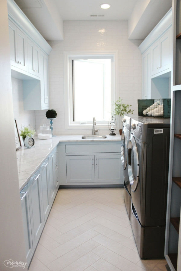 blue laundry room. light aqua laundry room paint. light blue cabinets