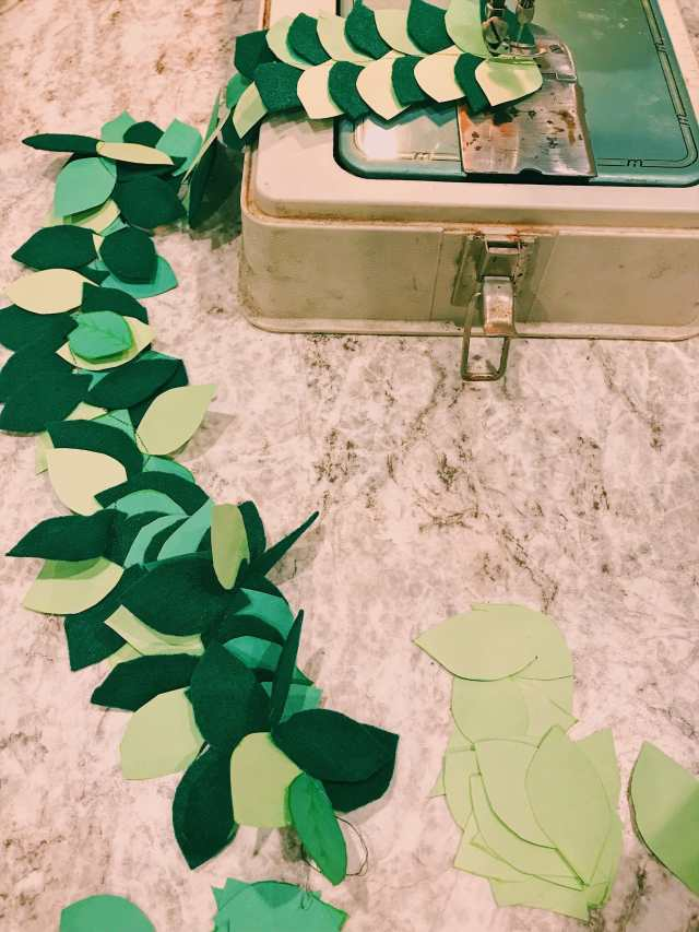 Sewing paper leaves to make a paper leaf garland