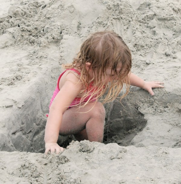 ...and no better way to get completely covered in sand than to jump into a hole and sit!
