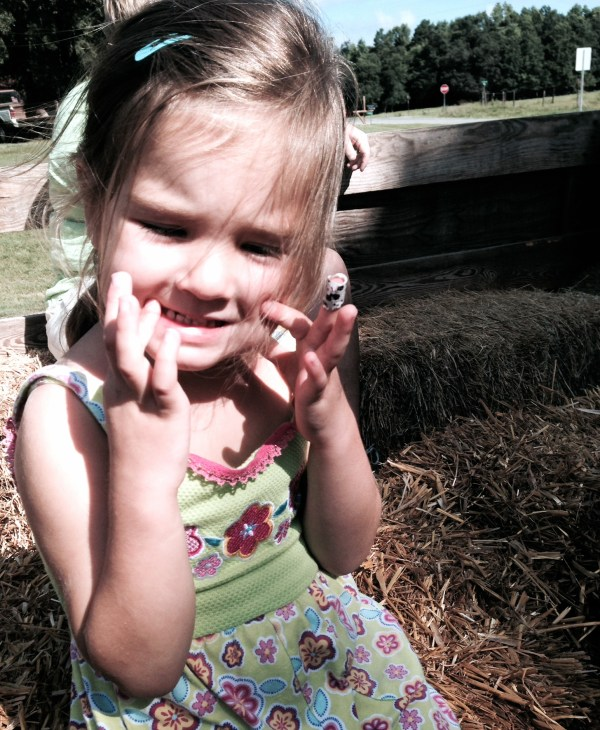 Maddie liked the hayride around the farm to see all of the cows.