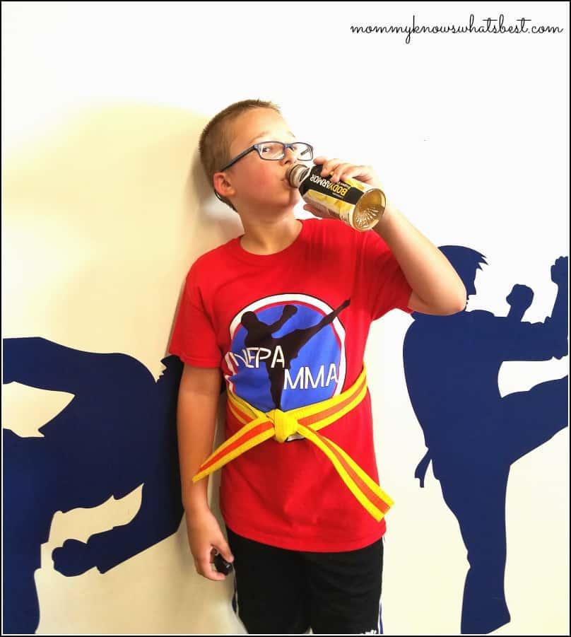 boy drinking body armor