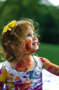 manage toddlers during coronavirus -girl similing with paint on face