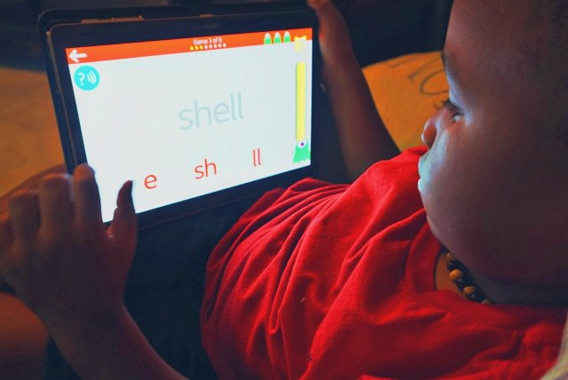 Child uses phonics on reading app