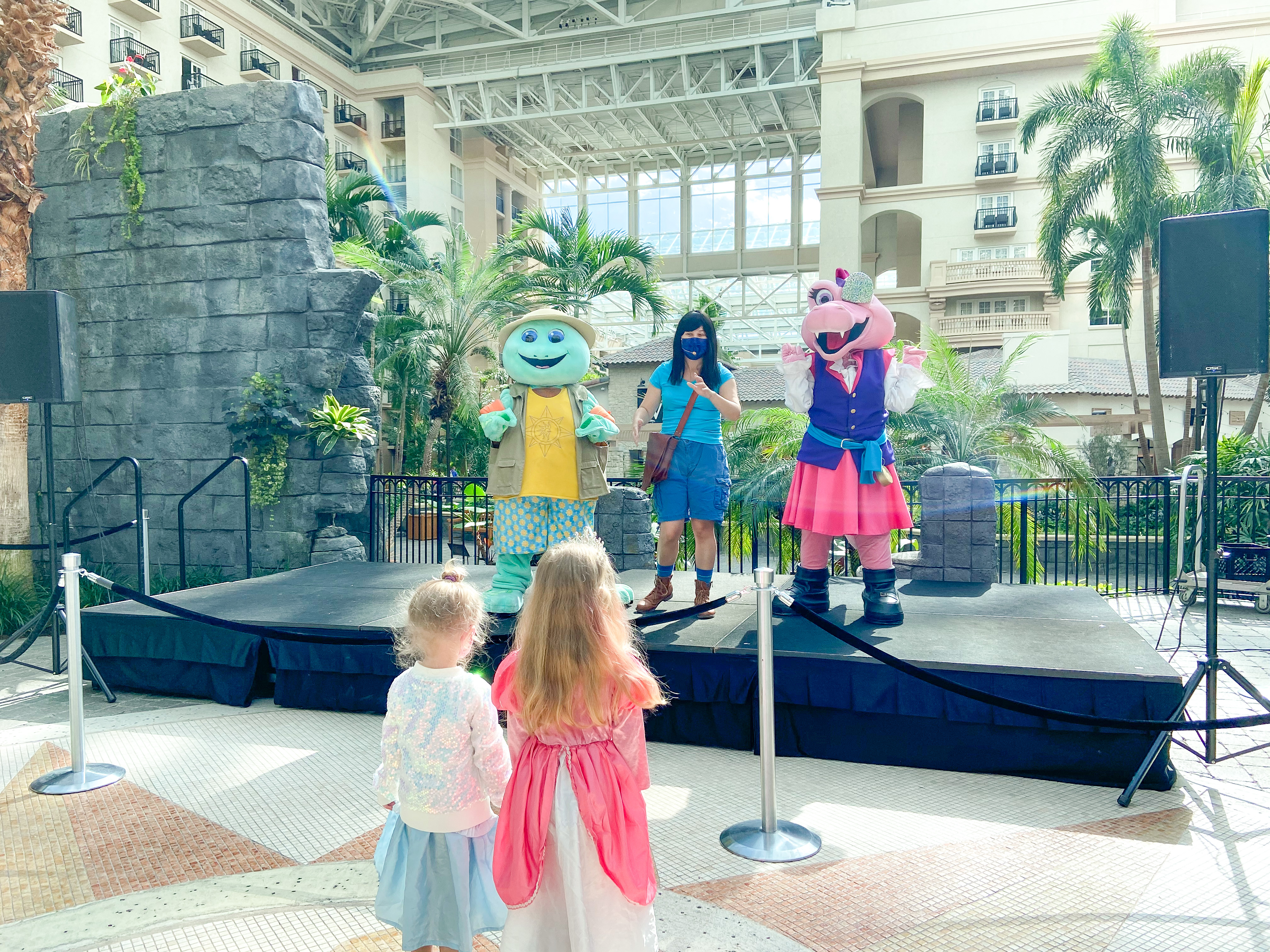 Pirate and Princess Weekendshave officially begun at Gaylord Palms Resort in Orlando, FL. Happening now through March 7, 2021, this immersive experience is lots of fun for guests of all ages. Pirate & Princess Activities at Gaylord Palms Special thanks to Gaylord Palms Resort for hosting my family and inviting us to experience Pirate and Princess Weekends. All opinions are my own. Pirate Pool Party Happening Saturdays and Sundays from 12-4 pm at Cypress Springs Water Park, this party includes lots of fun pirate themed music and is complimentary for all resort guests. Gaylord Palms has two large pools for swimming, plus a water park with various play areas for kids of all ages to enjoy. Treasure Scavenger Hunt Orangeblossom's Shiny Stash Treasure Hunt happens resort-wide at your leisure. The treasure chests are (mostly) easy to spot and carefully hidden around the St Augustine Atrium. Booklets are available for purchase for $9.99 at the Pool Towel Hut and also come with a fun prize upon completion. Adventure Kids: Join the Club Happening Saturdays at 12 pm, 1 pm and 2 pm, you can meet Seth the turtle and Ava the alligator as they earn their Goodness Badge and talk about the importance of making good choices. Kids even have the opportunity to talk to the characters and pose for a photo at the end of each show. While also adhering to social distancing guidelines. We watched the show once from our balcony and again up close. My girls loved it! The Princess Academy Happening on Saturdays at 1:30pm, 2:30 pm and 3:30 pm, The Princess Academy is a fun, interactive show with singing, sword fighting and also beautiful princesses. Princess Orangeblossom meets the swashbuckling Pirate Princess Sunshine and teaches her how to be a proper princess. Pirate Outpost Invasion This all-new immersive show happens Fridays and Saturdays and puts you right into the pirate action! The three part experience includes songs, sword fighting, and a chance to meet the pirate captain to join his 