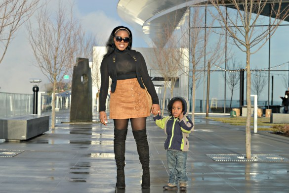 black mom- black mom and son- black mom with son- suede skirt- black over the knee boots- otk boots- black turtle neck-black vest