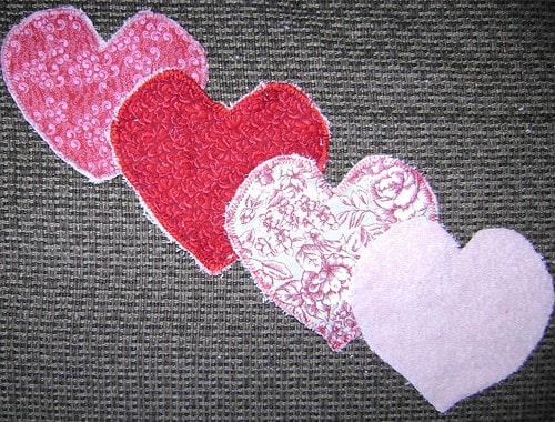 terry cloth cut into heart shapes and stitched using blanket stitch