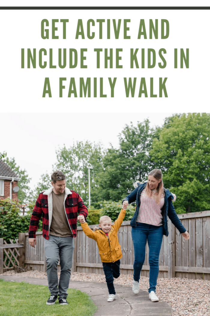 family going for after dinner walk
