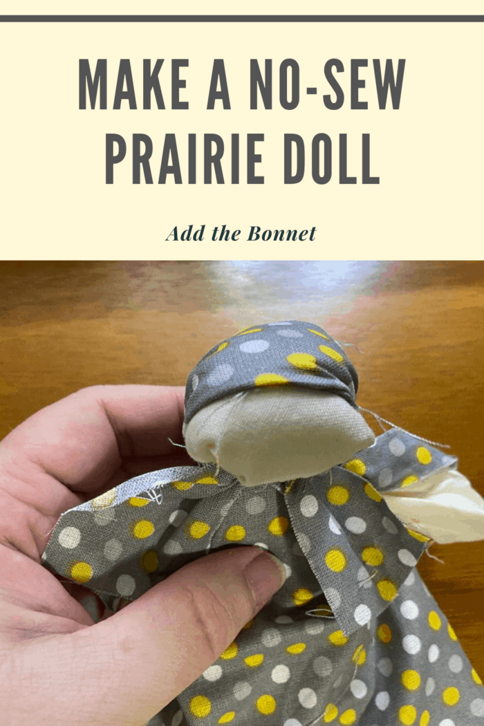 Add the bonnet by folding the 1.75-inches x9-inches piece of fabric over the doll's head and tie around her neck with a piece of yarn or like a bandanna.