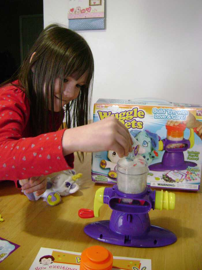 Adding the fluff and magic dust to the stuffing machine wuggle pet review
