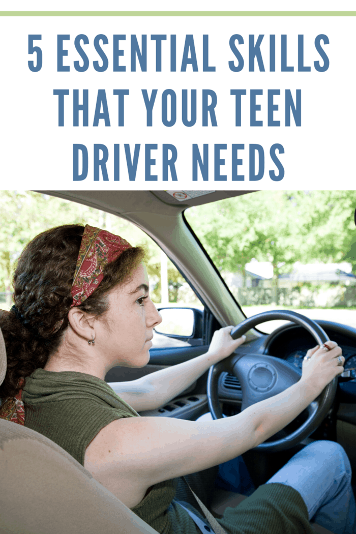 teen driver behind wheel with focus on the road