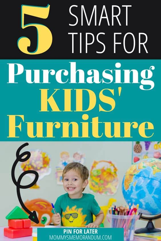small boy in room with new kid's furniture grinning from ear to ear.