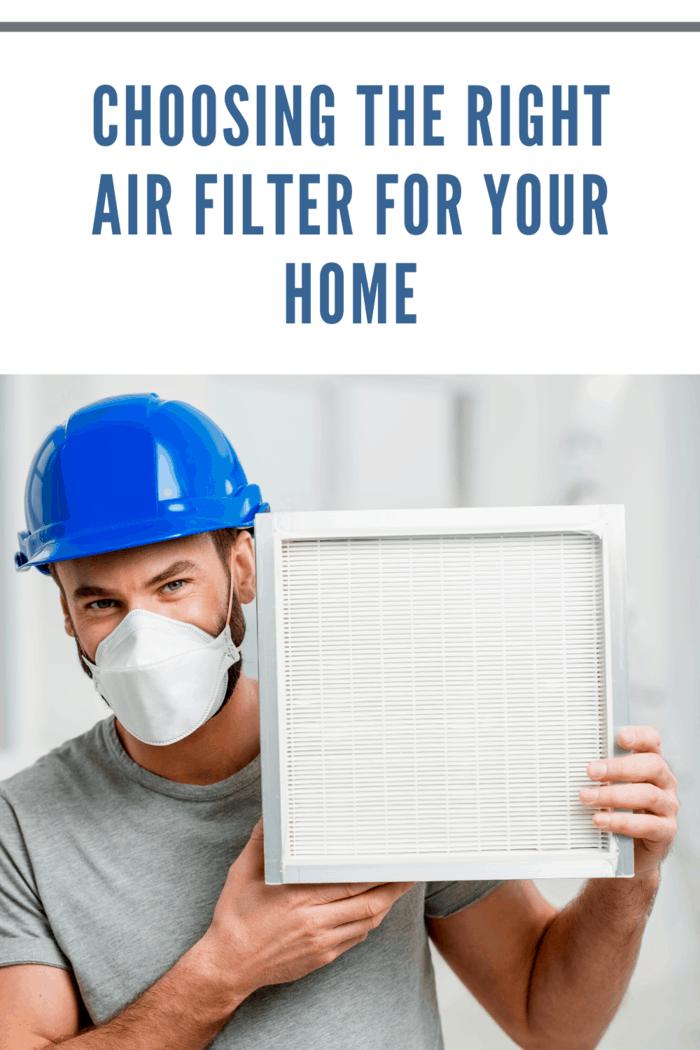 man holding air filter
