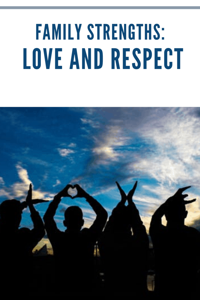 silhouettes of family using hands to spell out LOVE