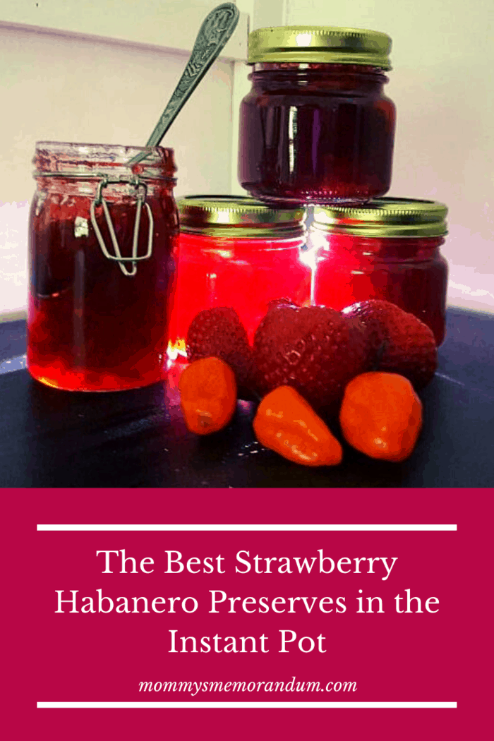 instant pot strawberry habanero preserve recipe made with light coming through jars and fresh strawberries in front of display